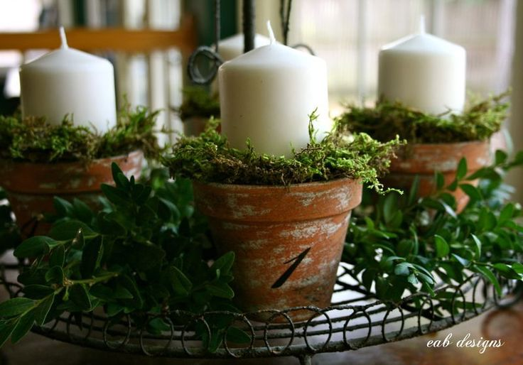 patina clay pots, add number from homemade stencil, candle and moss for advent candles---so pretty across the mantle