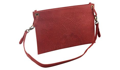 The leather embossing in West Bengal has reached its peak. Its beautiful handiwork showcased on this eco-leather purse is an art of its own. See more at newint.com.au/shop