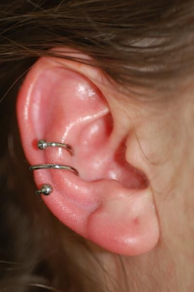 The conch piercing. My next crazy intention. Can be worn as stud or hoop (shown).  Inner part of the ear through the back. Healing time... 6 months...?