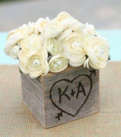 Engraved rustic box filled with lovely white roses perfect for a bridal shower centerpiece.  See more bridal shower decorations and party ideas at www.one-stop-party-ideas.com kim dunn