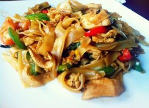"Thai Drunken Noodles (pad kee Mao). I substitute beef for the meat.  Sooo good spicy and sweet!  Also, the Asian food store has rice noodles you can slice at home...1"" wide noodles in this are awesome!!"
