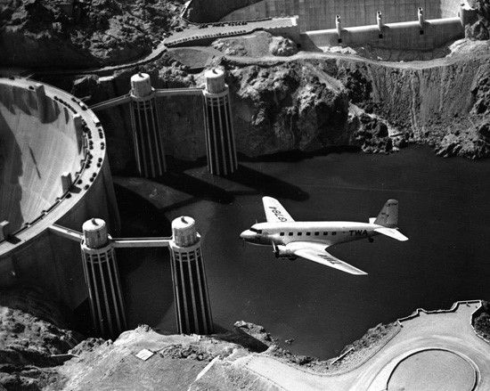 1936 - View showing a Douglas DC-2 flying over Hoover Dam. Note the water level. From the collection of the San Diego Air and Space Museum  - Water and Power Associates