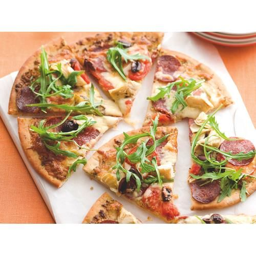 The topping options for these speedy Italian pizzas are limitless. Try shaved ham, any other type of dip you fancy, or a handful of pineapple chunks, just to keep the kids happy.