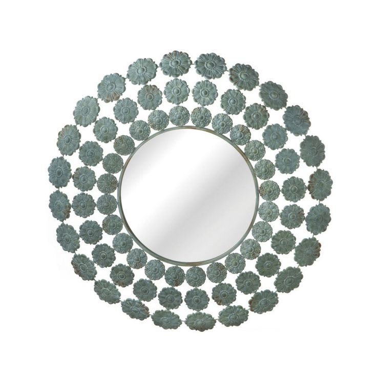Old World style gets a modern, feminine touch with this lovely wall mirror. The frame radiates out with rings of small, antiqued metal flowers for surprising textural interest.