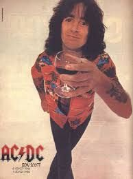 Bon Scott of AC/DC 7/9/1946 - 2/19/1980.  After drinking heavily at a bar.  Bon Scott went to pass out in a friends car.  The friend did not return to his car until the next day, where he found Bon Scott unresponsive.  He called 911 and after the  paramedics arrived, he was pronounced dead at the scene.  The coroner listed his death as Acute Alcohol Poisoning.  The band hired Brian Johnson 5 months later.  His voice was eerily close to Bons.