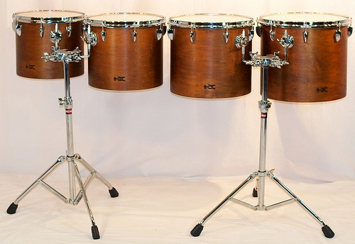 Light Brown Concert Toms:  The bottom 4 drums out of the complete set of 8 concert toms, finished in Light Brown.  Each pair of drums include a Gibraltar 7700Q stand.  Multiple set-ups are made easy by accessorizing with these sturdy stands. 11x13, 12x14, 13x15, 14x16; plied maple; semi-gloss wax. To see more pix, and search our entire TreeHouse archive for your favorite specs, visit our photo gallery:http://www.flickr.com/photos/treehousedrums/collections/