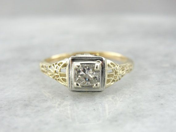 Completely unique and one of a kind! Made of 18 karat green gold with a white gold mounting, this ring is a modern update on the classic Art Deco