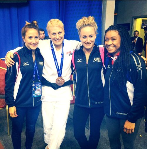 Kayla Harrison smiles with NYAC and Team USA teammates shortly after winning a bronze medal at the 2014 Judo World Championships.