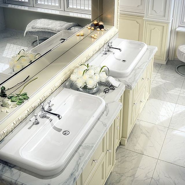 """The Lario 100 Solo sinks may be paired for a """"his and hers"""" effect or used individually for an elegant focal point.  Like all Victoria + Albert products, they are crafted from ENGLISHCAST, the brand's signature composite of Volcanic Limestone and resin that is durable and provides a high gloss finish.  @victoria_albert_baths #luxurybathroom #interiordesign #bathroomdesign #bathroomvanity"""