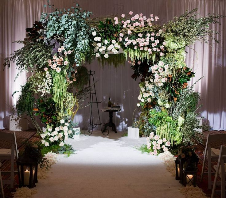The hanging amaranthus adds the final touch to this beautiful ceremony by @nancy_kaye @marksgarden (Venue: @ojairesort   Planner: @internationaleventco   Band: #TrafficJamm   String Quartet: #EllieBunker   Florist: @marksgarden @nancy_kaye   Photographer: @johnandjoseph   Videography: @elysiumweddings   Lighting: @images_lighting   Wedding Cake: @crushcakesgoleta   Décor: @edgedesigndecor   Rentals: @harryspartyrental   NY Desserts: @levainbakery #carnegiedeli @breadsbakery   Mini Donuts…