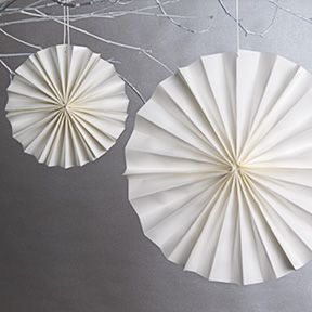 How To Make Paper Rosettes These paper decorations are so easy to make and work wonderfully as party decorations for any event. Use lovely paper rosettes as bridal shower decorations hanging above a serving table or gift table. Hang from tree branches at a summer dinner party or use as wedding decor. Match any theme...