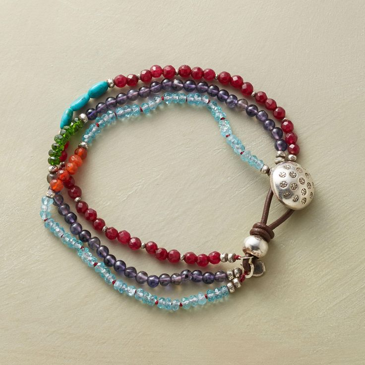 """CHLOE BRACELET�--�Overlapping strands create an interplay of smooth blue iolites, apatite rondelles, faceted red jade, chrome dioxide, carnelian and turquoise beads. Each strand with a contrasting centerpiece. Leather and sterling silver button clasp. Handmade exclusive. 7-1/4""""L."""