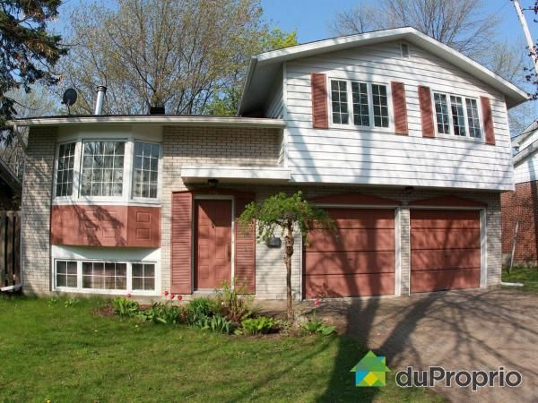 Beautiful 4-bedroom home located in Preville sector of Saint-Lambert. Huge double garage, spacious yard with gorgeous mature trees, and bright, modern basement with bamboo floors and wood fireplace. Lots of storage space!