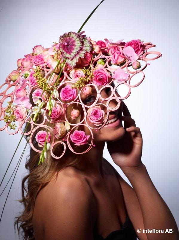 Blommor, hatt - blomsterkreationer på hög nivå.