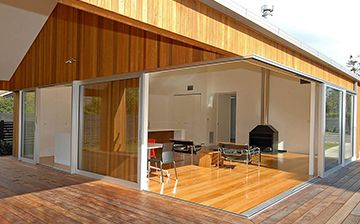 Clean and oil our cedar cladding to bring it back to its natural colour