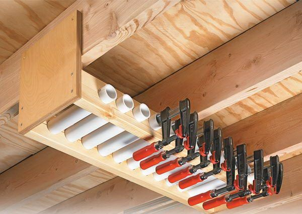 Garage Overhead Clamp Rack. Short lengths of PVC pipe held in the rack serve as compartments to store each clamp individually. By lining the pipes up side by side, have easy access to the exact size of clamp needed. http://hative.com/clever-garage-storage-and-organization-ideas/