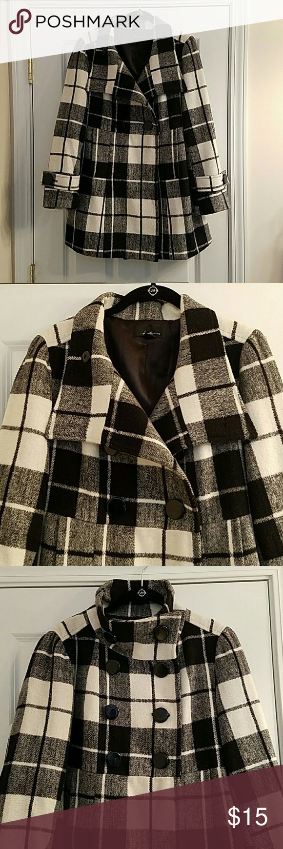 Black & White Plaid Double-Breasted Peacoat Warm double-breasted peacoat. Buttons up 2 different ways for style diversity. Medium weight ideal for fall/ early winter evenings. Classic black and white plaid pattern Forever 21 Jackets & Coats Pea Coats