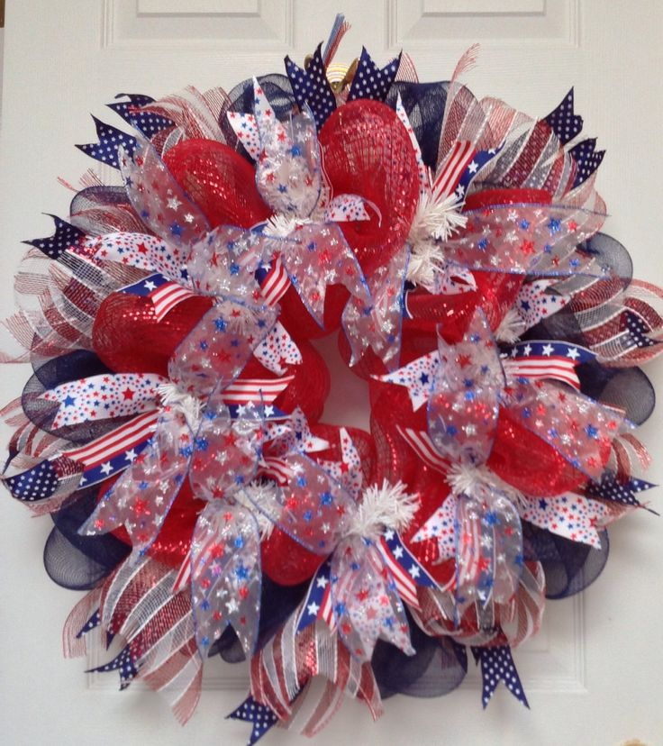 A personal favorite from my Etsy shop https://www.etsy.com/listing/221945443/patriotic-ribbon-deco-mesh-wreath