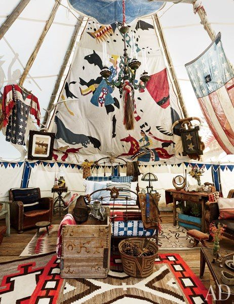 Summer Guest Teepee at Ralph Lauren's Double RL Ranch in Colorado :: A remnant of an original chief's tepee hangs over the Victorian cast-iron bed, which is topped with antique bedding and Ralph Lauren Home shams; the chandelier is also Victorian...