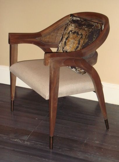 """I used to work at a gallery in New York that sold antiques mixed with 20th C. designed furniture. My boss would take consignments, some of them from Albert Hadley. One time Albert brought in a pair of Edward Wormley-designed """"Captain"""" chairs. Ever since then I've always loved this chair. I found this one in a resale/consignment shop. I think this one has had the black stain removed and has been done in a greyish cerused/limed finish. Love it!"""