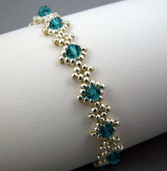 This listing is for a lovely diamond weave bracelet. I created this original pattern beadwoven bracelet using Toho permanent finish aluminum beads and embellished with 12 - 4mm Caribbean blue Swarovski crystals. The bracelet is 6 1/4 (16cm) in length and just 3/8 (0.9cm) wide with a button and beaded loop closure. Did you know that well-made beadwoven pieces can be very durable as evidenced by highly-valued vintage beadwork available in the antiques market? Given the same care you take ...
