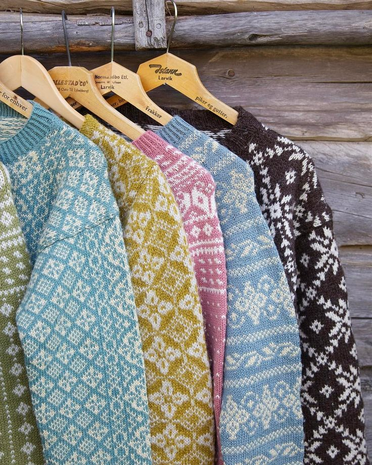 Selection of colourful knitted Scandinavian jumpers for winter hygge