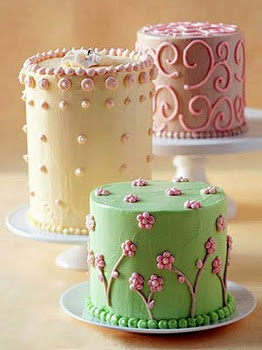Tiny Tall Cakes- Divide batter among 28-ounce tomato cans, place on a baking sheet and bake at 350 for 30 to 35 minutes. When cool, remove cakes from cans by running a knife around the edge and tapping gently. (You can chill them for easier cutting) Cut cakes into layers about 1/2 inch thick, discarding the domed top. Stack with icing to make cakes of different heights. Smooth a thin layer of buttercream all over each cake, chill for 30 minutes, and frost again. Decorate with piped designs