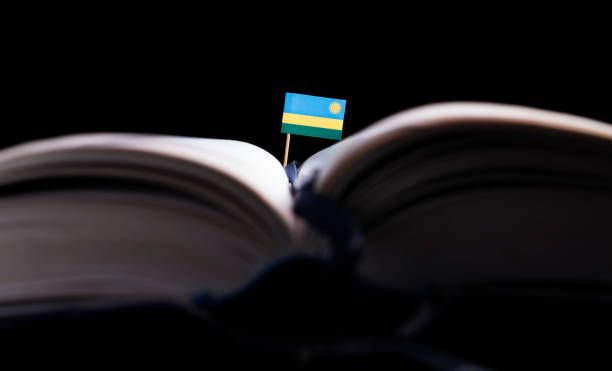 rwanda flag in the middle of the book knowledge and education concept