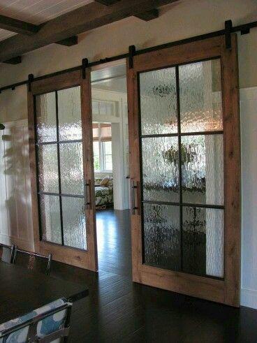 http://www.chrislovesjulia.com/2014/08/a-new-project-25-of-the-best-modern-barn-style-doors.html