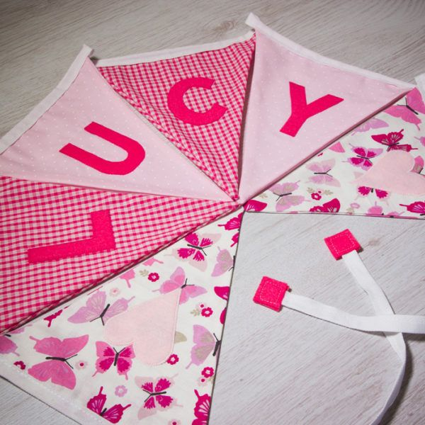 Handmade classic baby girl bunting, personalised with any name. Each flag is carefully produced by hand therefore can be made to suit your own ideas. #personalised #bunting #giftguide #instagift #mumsinbusiness #blanket #taggies #unique #gift #babygifts #aprons #towels #instacool #fabric #nurserydecor #nursery #handmade #kidsgifts #giftideas #present #babyshower #christening #birthday #presents