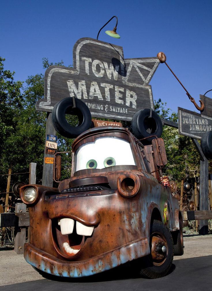 Mater In Cars Land at Disney California Adventure Park... Planning trip for kids here angel lil man and baby Hayden would be In heaven