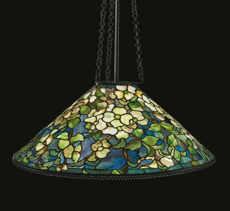 "Lot | Sotheby's GEYER FAMILY COLLECTION TIFFANY STUDIOS ""DOGWOOD"" CHANDELIER shade impressed TIFFANY STUDIOS/NEW YORK leaded glass and patinated bronze 68  1/2  in. (174 cm) drop 28  3/4  in. (73 cm) diameter of shade circa 1905 Estimate 120,000 — 180,000 USD  LOT SOLD. 149,000 USD  (Hammer Price with Buyer's Premium)"