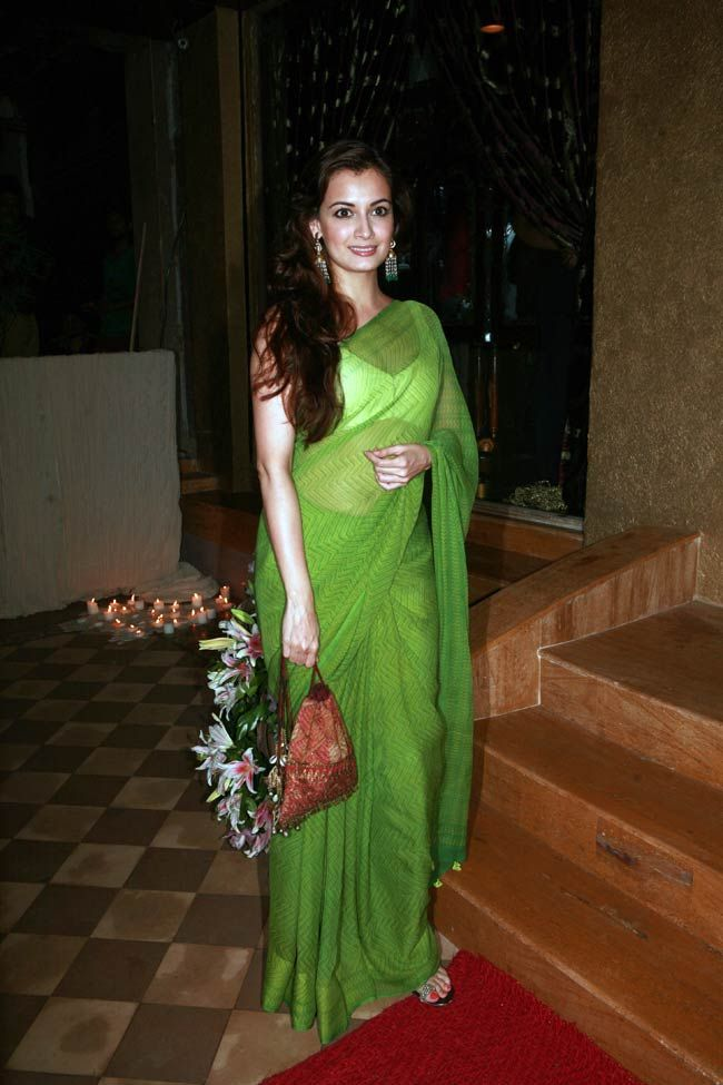 Diya Mirza looked ravishing in a green saree at the opening of designer and socialite Queenie Dhody's jewellery store - 'Jewel of Queenie'. #Bollywood #Style #Fashion