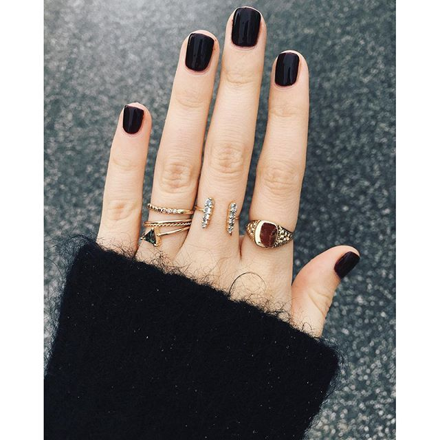 Black polish and rings on every finger. We love this look.