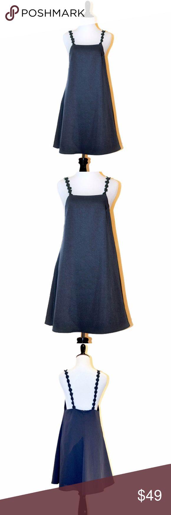 NWT Eric + lani Daisy Strap Grey Mini Dress Daisy Strap Mini Dress New With tag  Grey 100% Polyester Mini dress Hand wash cold, No care label Brand: Eric + lani Size Small Eric + lani Dresses Mini