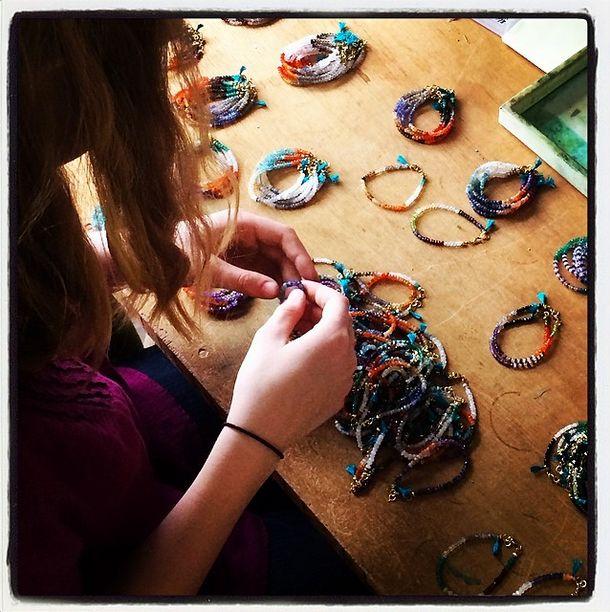 Making + sorting gemstone tassel bracelets  We Dream in Colour studio