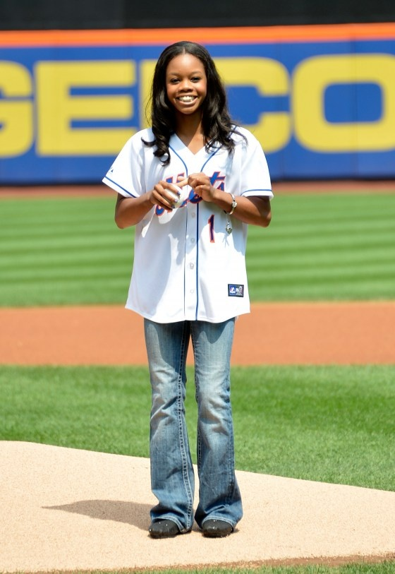 London 2012 Olympic games gold medalist Gabby Douglas throws out the first pitch at Citi Field on August 23, 2012 in New York City.