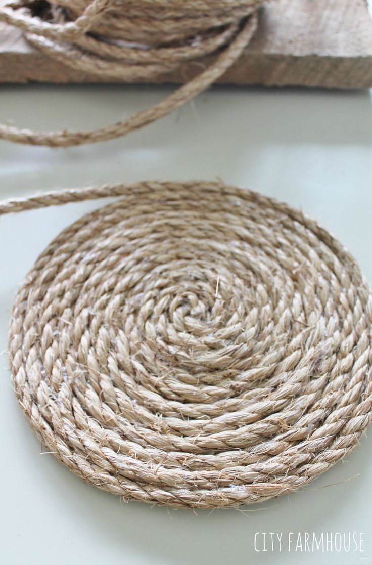 Pottery Barn Inspired Round Jute Placemats- Using hot glue gun wrap jute all the way around
