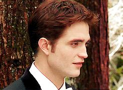 gif, click thru, Rob is making a funny face at Kristen