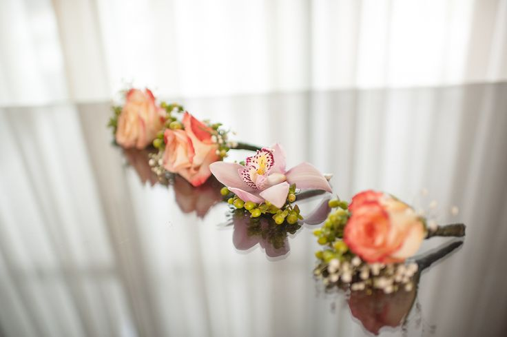 My diy bridal boutineers.  Cymbidium orchid for hubby and roses for the grooms men.