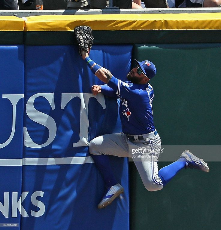 Kevin Pillar #11 of the Toronto Blue Jays collides with the wall trying to catch a home run ball, that gets stuck in the padding, hit by Brett Lawrie of the Chicago White Sox in the 2nd inning at U.S. Cellular Field on June 25, 2016 in Chicago, Illinois.