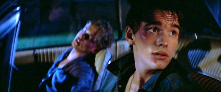 """I've always loved the expression on Dally's face here. """"Oh no, officer, I'm sweet and innocent."""" lol. (The Outsiders, 1983)"""