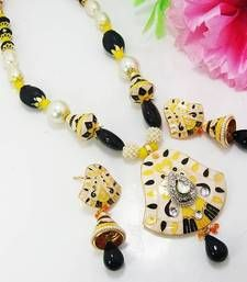 Material Used : Meenakari    Necklace    Length : 23 cm    Width : 4 cm      Earrings    Length : 6 cm    Width : 2 cm  Weight : 60 gms