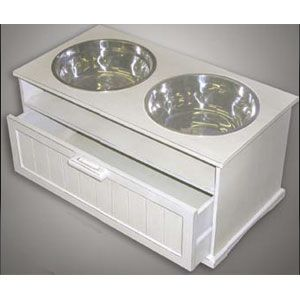 A raised dog bowl with a storage drawer. I bet you could paint and personalize it too. This would be great if it were high enough for Luna- she's long outgrown any bowls we can buy here in town, so on the hunt for an adult sized bowl for her!