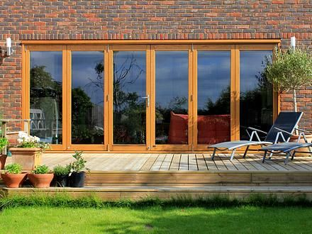 Outside view of the Vufold Elite 16ft External Aluminium Clad, Real Oak Bifold Doors, Detached, Greater London