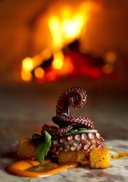 ... fire-roasted octopus with crispy potatoes and smoked paprika aioli