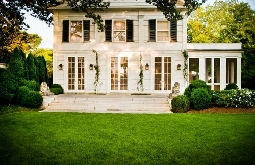 Yes! White with dark shutters, french doors and a screened in porch