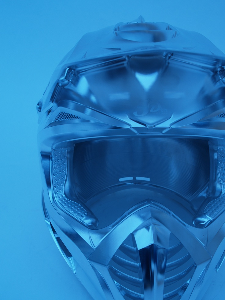 The blue collection: Motorcycle helmet in Alloy – with the 5 axis strategies from hyperMILL, geometrically complex parts that up to now could not be  milled or only with a great deal of manual eff ort can now be manufactured cost eff ectively.