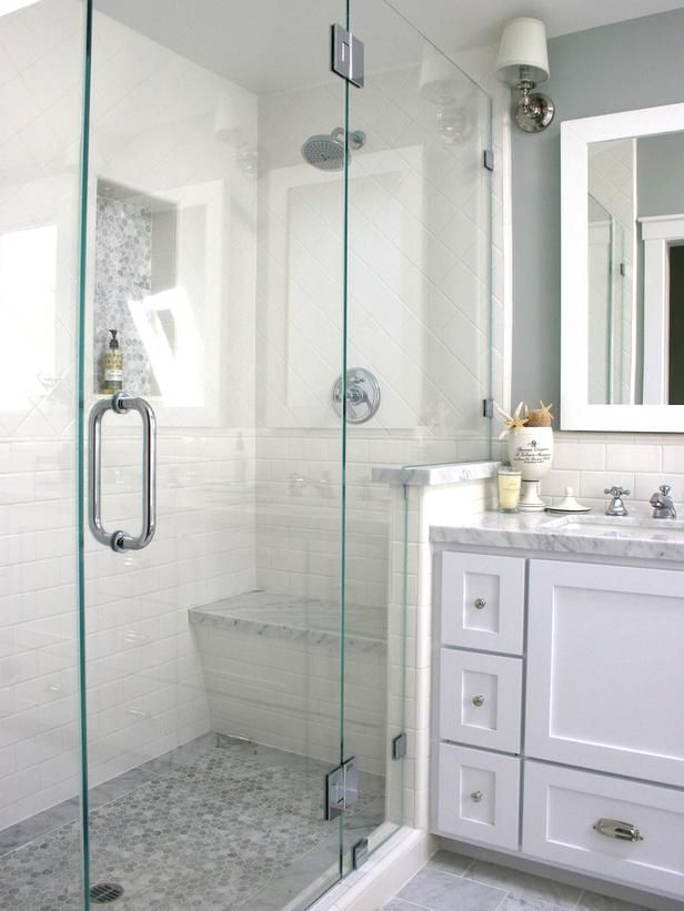 shower door location/swing direction Marble & white bathroom  -- I like the shape of the bench in the shower