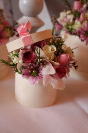 small boxes filled with fresh flowers